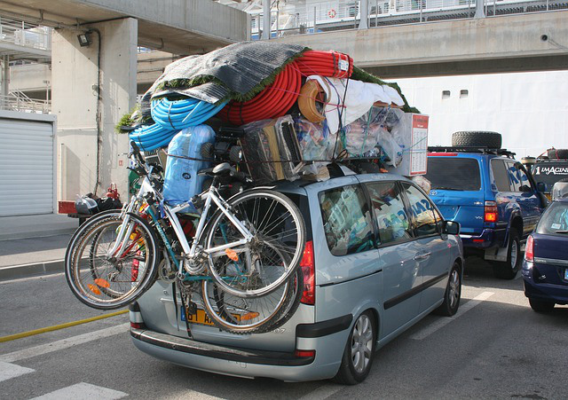 An Image of a Vehicle Overloaded With Items