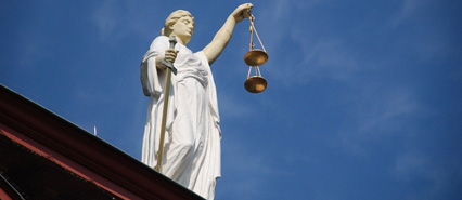 Image of a Statue Holding Scales of Justice