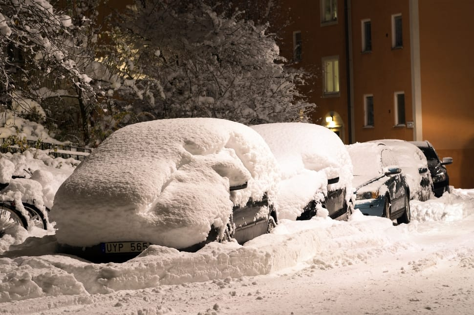 An Image of Snow Covered Cars